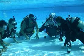 Some Off The Wall Divers enjoying training to dive in the Grand Caymans